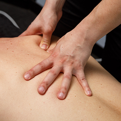 A Flexed massage practitioner relieves stress and pain for a patient at Flexed Melbourne